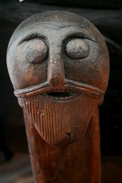 Human head carving on the Oseberg Wagon Carved human head with moustache and beard from the Oseberg wagon.