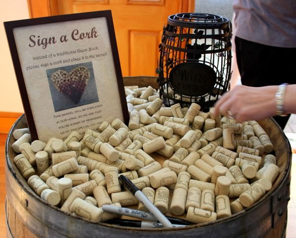 wine corks for guest book   Of course, what wedding would be complete without a photo shoot with ...