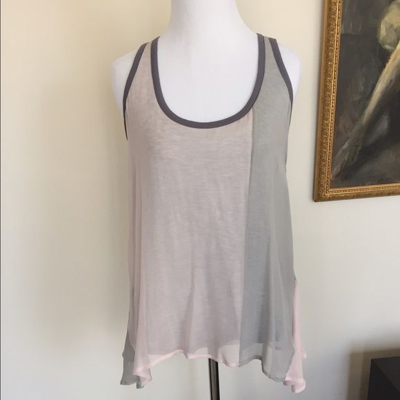 """ella moss Pale Pink & Grey Racerback Tank One of a kind! The top layer of fabric is pale pink & light grey 100% silk. The layer underneath is heather grey 100% modal. The piping along the neck & arms is dark grey 100% modal. The silk sides are longer {31""""} with shorter center front {27""""} and back {28""""}. The layer under is slightly shorter than the top. Silk layer has a few tiny snags that are unnoticeable, because it's flowy ~ shown in the fourth photo. Price reflects this. Ella Moss Tops…"""