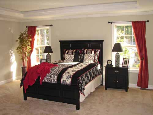 Spacious master bedrooms....not the colors, but similar look to our master w/the windows