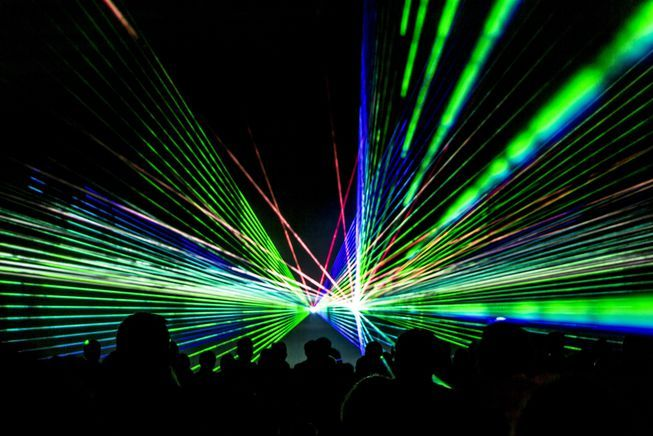 People Awash In Lasers At Laser Show Laser Show Laser How To Play Drums