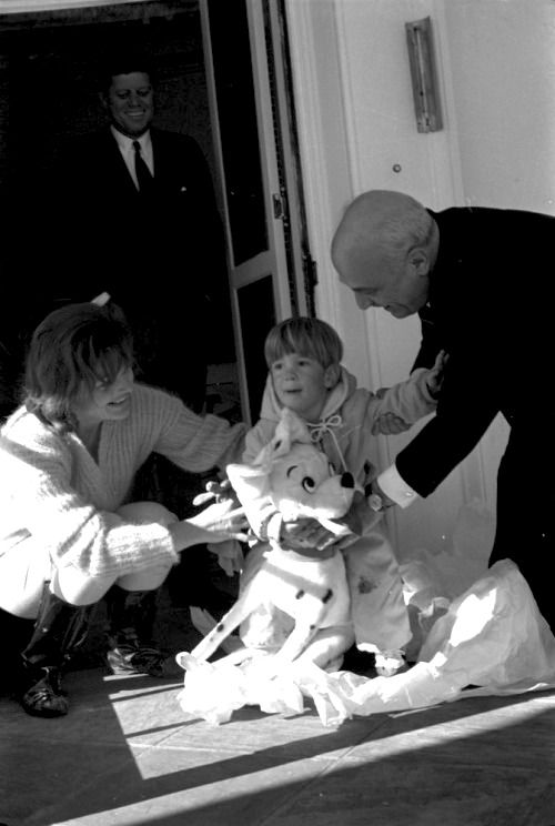 Jackie Kennedy, JFK & John F Kennedy Jr 17 January 1963. John F Kennedy Jr plays with gift from Prime Minister of Italy, Amintore Fanfani.