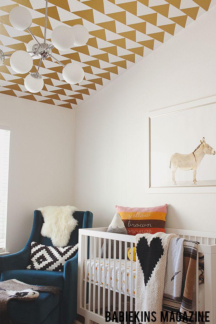 white crib + modern chandelier + animal print + gold print ceiling
