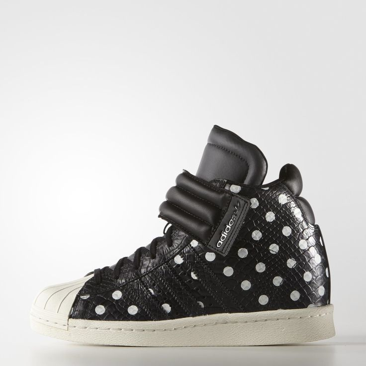 The adidas Superstar sneaker goes sky-high with a hidden wedge heel. These  women's shoes flash polka dots on the snakeskin-embossed upper.