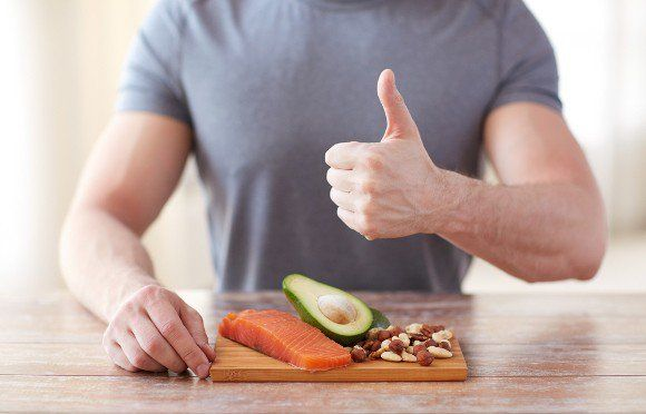 Thumbs Up Man With Salmon Avocado and Almonds