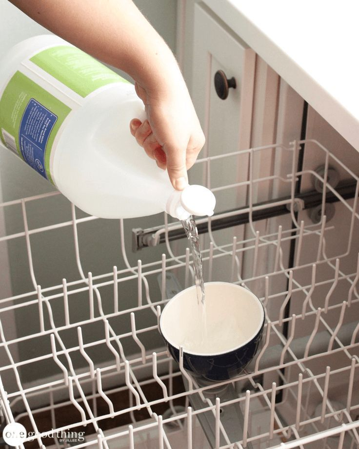 How To Clean Your Dishwasher Dishwasher Safe Cup Filled With Plain White Vinegar On The Top Rack Of Yo Cleaning Your Dishwasher Cleaning Hacks Clean Dishwasher