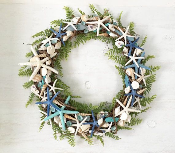 Beach Wreath, Coastal Wreath, Seashell Wreath, Starfish Wreath, Beach Decor, Coastal Decor, Shell Wreat  This classy beach wreath is available in two sizes and would look great over a fireplace, on your front door, or maybe as a lovely beach wedding gift! Some of the shells have been hand picked, by my husband and I, off the Florida Gulf Coast Beaches near Sarasota, where I live.  This wreath is made for indoor use only--or it can be hung in a lanai or protected area. Wire loop on back to…