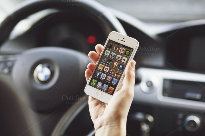 iPhone 5 in a car photo by show it better on Creative Market
