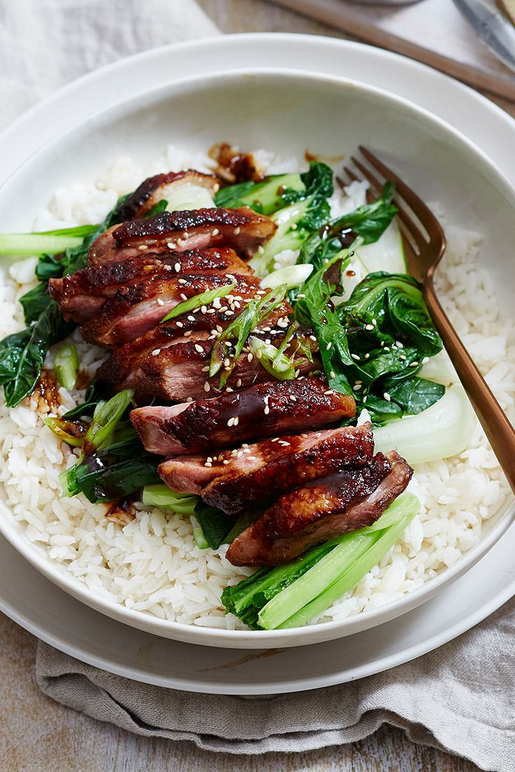 This Chinese-style crispy duck breast is finished off with a sticky, sweet sauce and is served with fluffy rice and steamed greens for a winning family dinner idea.
