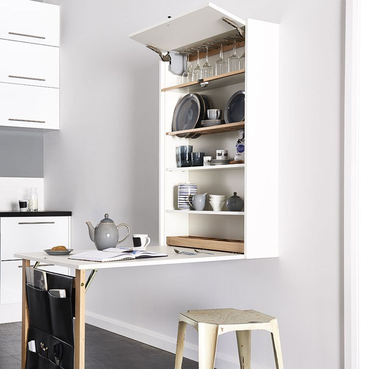 This minimal wall-mounted shelving unit by Magnet stores crockery and glassware…