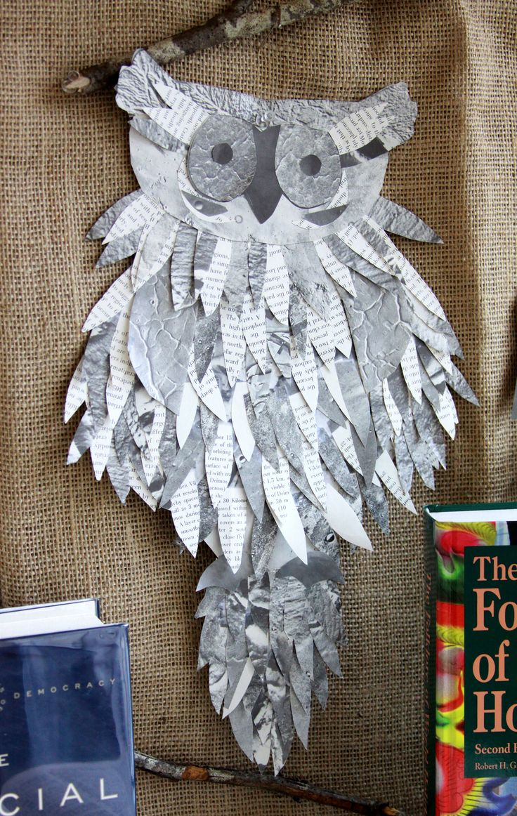 Owl made from discarded book pages for library reference collection display.