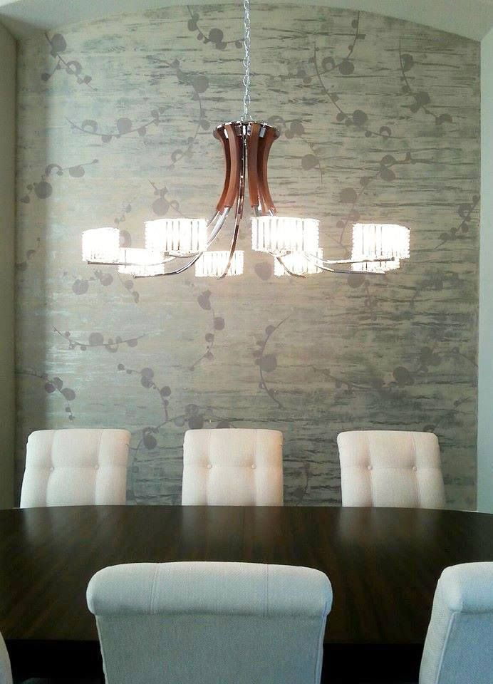 Dana DeBuck & Cindy Howard of Decorative & Faux Finishes used Modern Masters Metallic Plaster to create a stunning accent wall finish in a dining room.
