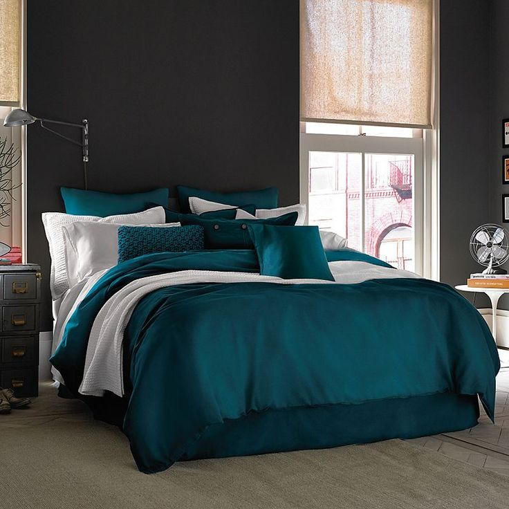 Dark teal for our new king size bed! Matching shams and king size duvet to put inside Don't know about the bed skirt - Because of the frame I don't know what to do