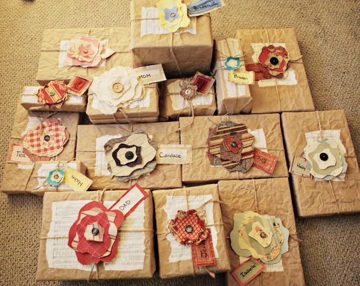 Brown paper, twine, and colorful paper flowers gift wrap.