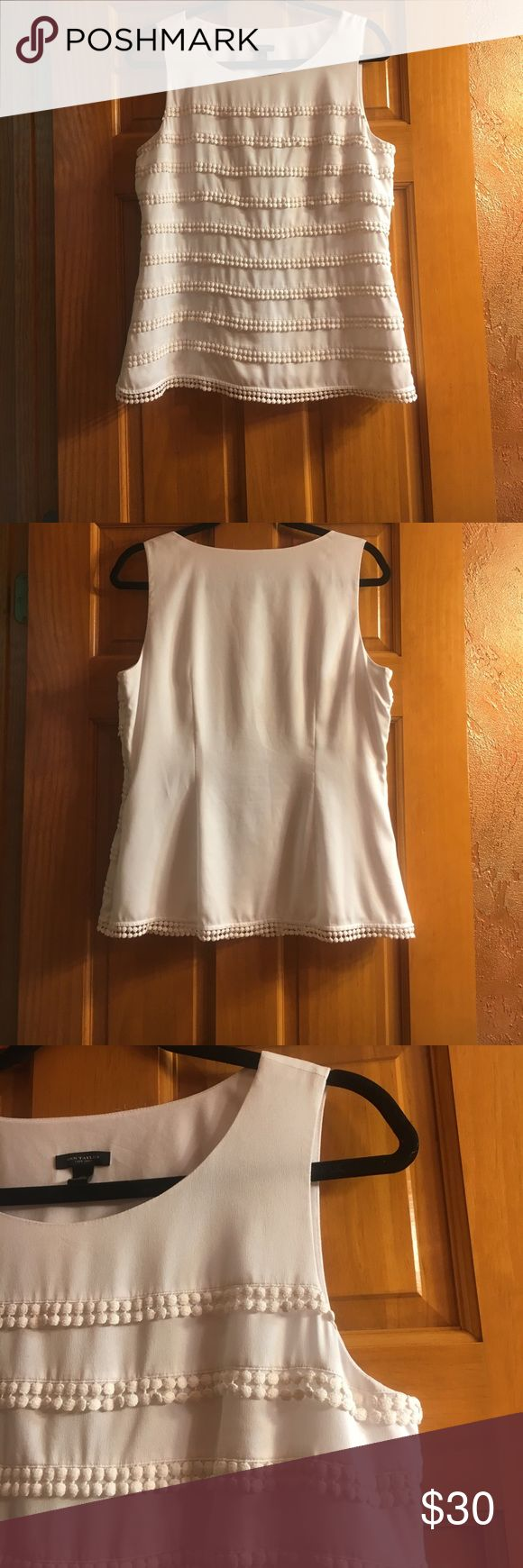 Ann Taylor White Sleeveless Blouse 🕊 Ann Taylor White Sleeveless lined Blouse 🕊 Size: 10 Perfect condition, only flaw are a few loose threads that are very unnoticeable. {See photo} Features include: Small functional hidden zipper on side, circle fringe detailing (off white, light cream), no fading(bright white), lined & 100% Polyester! Perfect for the office, dress it up or down!! {Measurements upon request} Ann Taylor Tops Blouses