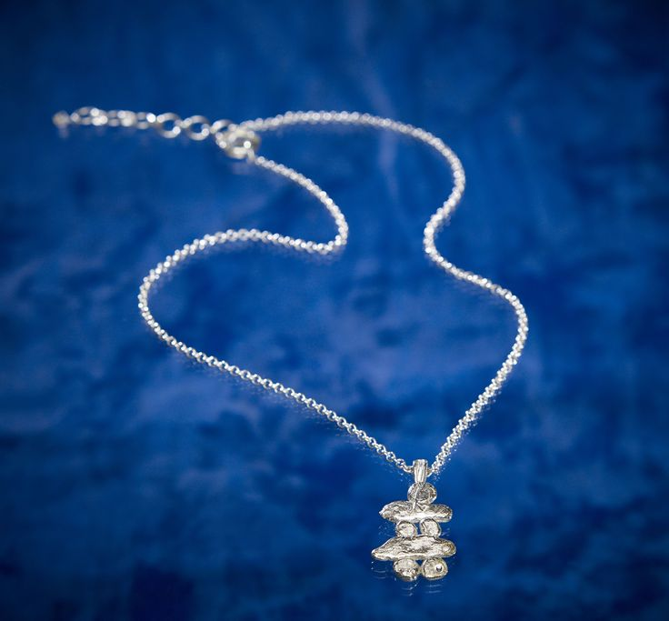 Sterling Silver Large Inukshuk on Chain by Arctic Ice Jewels. A representation of our Northern First Nations Aboriginal People.