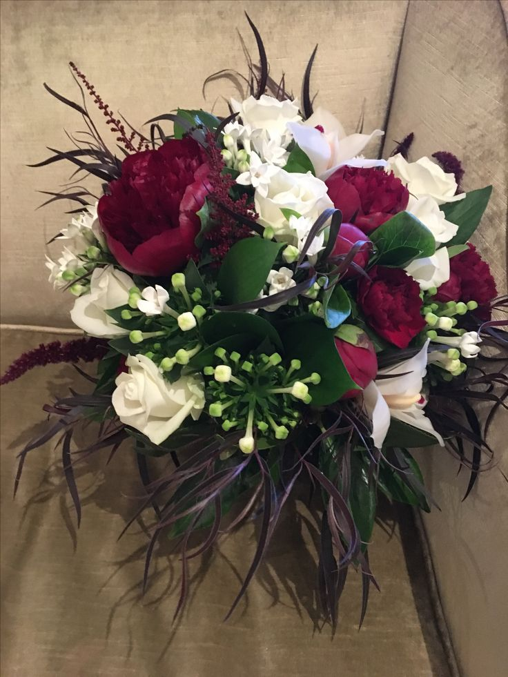 Bouquet of peonies, bouvardia, roses, cymbidium orchids and carnations with Agonis foliage