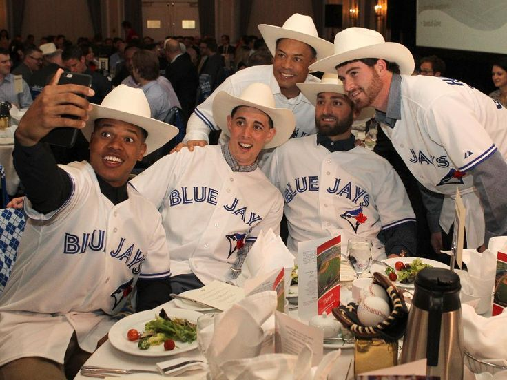 Current Blue Jays Marcus Stroman, Aaron Sanchez, Drew Hutchison and Kevin Pillar along with former Blue Jay Roberto Alomar take a selfie after getting white hatted at the Calgary Baseball Luncheon supporting the Okotoks Dawgs Youth Baseball Academy and amateur baseball in Alberta