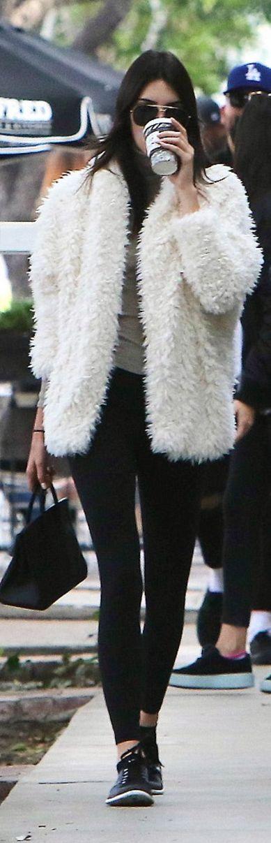 Kendall Jenner: Sunglasses – Saint Laurent Purse – Hermes Shoes – Nike Sweater – Joe's Coat – Express