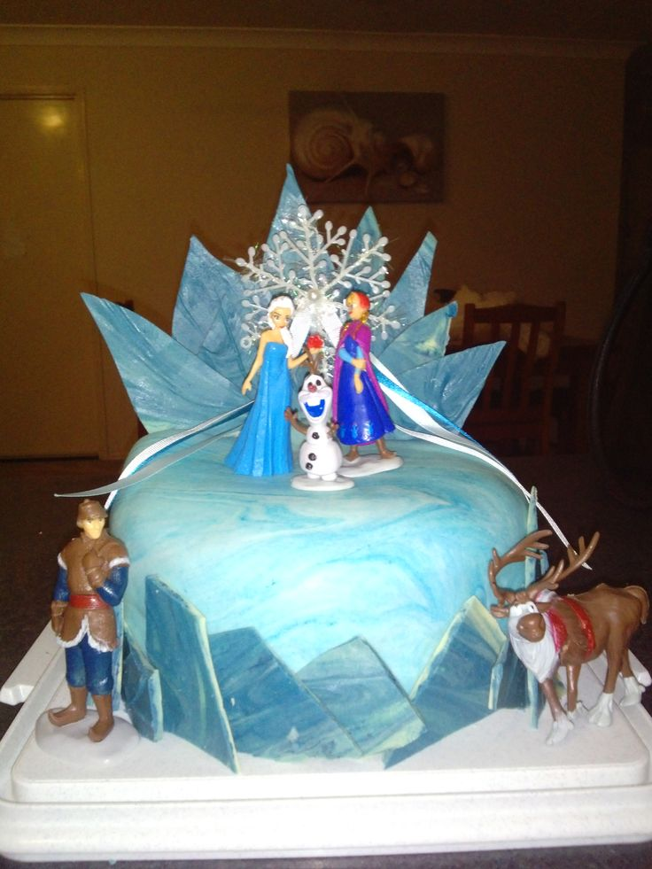 Frozen Elsa/ Anna/ Olaf/ Sven/ Kristoff/ Snowflake blue marbled fondant cake by Bubblegum Treehouse on Facebook with shards of blue chocolate to make the ice effect around the cake