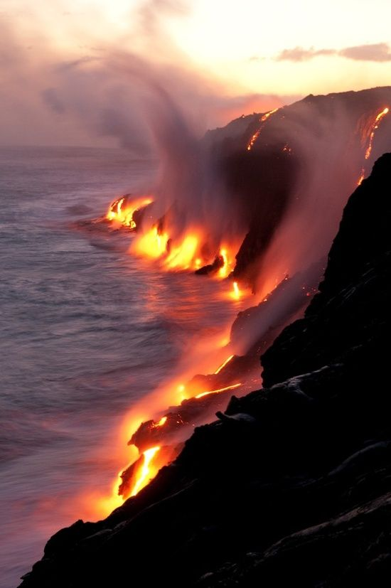Starting at Kalapana, Hawaii you can walk for two hours to the place on the coast where active lava flows touch the ocean. This is insane.