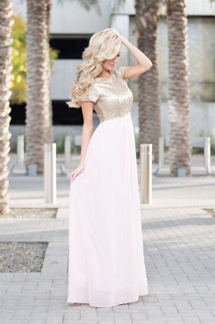 The Elsa features a short sleeve, round neckline bodice that is covered in tiny gold sequins and followed by a long champagne pink chiffon maxi skirt. Dress is fully lined with back zipper closure. Pink Gold Sequin Modest Bridesmaids Dresse