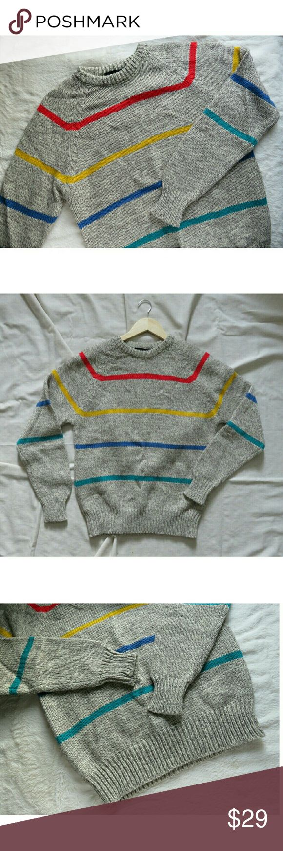 """Vintage Chunky Knit Sweater Rainbow Stripes Med Colorful and cozy chunky knit vintage sweater from Darby Sportswear! Marled gray & tan with bold primary color stripes (red, yellow, blue, green). 85% acrylic, 15% wool, wide cuffs at waist and sleeves, crewneck. Unisex size Men's Small or Ladies Medium, (oversized Small). Measures lying flat approx 20.5"""" across chest, 26"""" from shoulder to waist, and 23.5"""" from shoulder down sleeve to wrist. Soft and #sweaterweather ready! Packed carefully and…"""