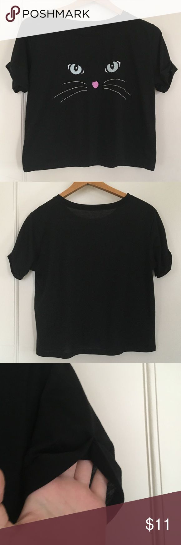 REDUCED🔥 Black Cat Crop Top Black crop top with an embroidered cat face on it. I got it from SheIn a while back and when it arrived, I noticed the care tag had been cut off so I can't tell you what material it is. This is shown in the last image. I believe it was listed as OS but it fits like a S/M. The stitching is okay, but not amazing. Reasonable offers welcome :) SheIn Tops Crop Tops