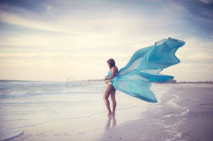 Beautiful Maternity portraits on the beach! I absolutely love this maternity gown from Roses & Ruffles!  By Essentia Photography | Tampa FL www.essentiaphotography.com