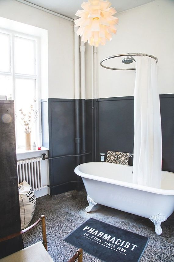 An industrial bathroom with a Norm 69 pendant from Normann Copenhagen via My Paradissi. Photo by Camilla Stephen.