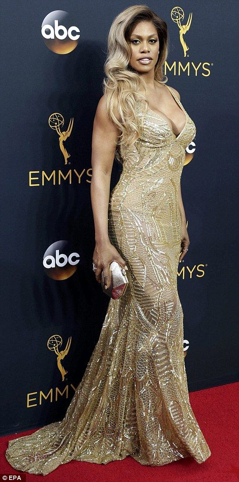 Channelling old Hollywood glamour: Laverne Cox was dazzling in her slinky and low-cut golden gown