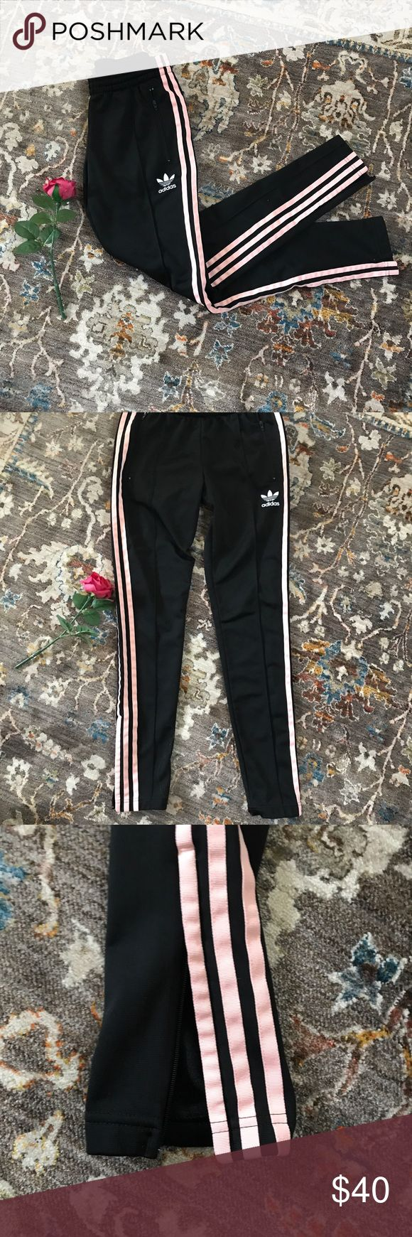 Adidas skinny ankle track pants Adidas track pants with light peachy pink stripes. Low rise, skinny ankle cut. Zips at the ankle and zip pockets. Very good condition! adidas Pants Track Pants & Joggers