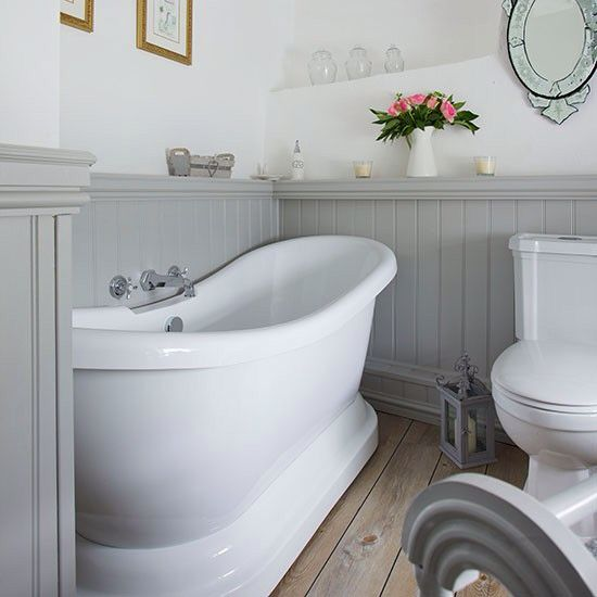 Cottage bathroom. Bottom half gray beadboard with touches of blue