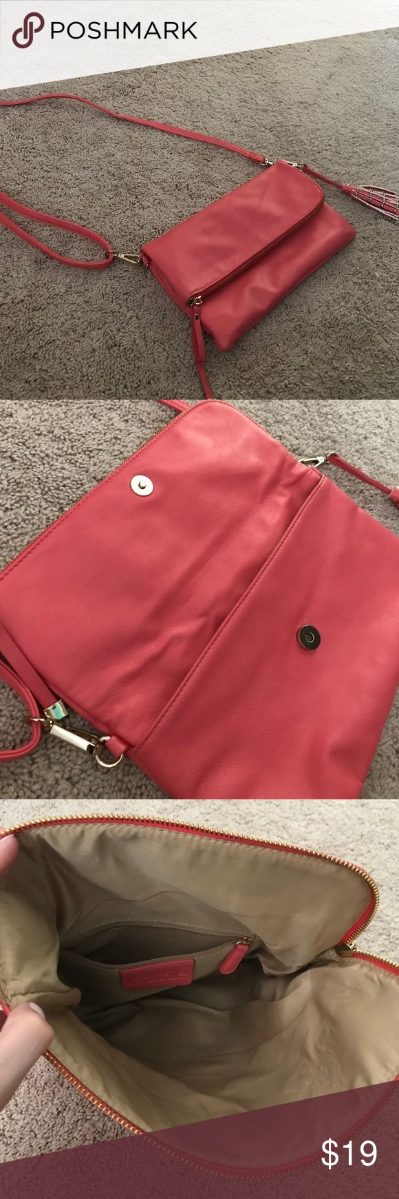 Coral crossbody Excellent condition, used once for a couple hours. Flops over and has a zipper part and opens up to a pocket. Has small pocket inside sipper part Charming Charlie Bags Crossbody Bags