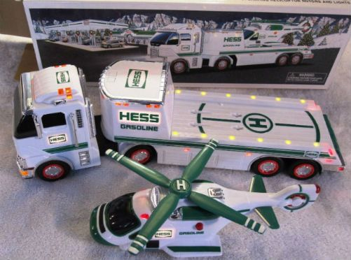 Vintage 2006 Hess Toy Truck and Helicopter. The heli is back and it's better than ever! The 2006 Hess Toy Truck and Helicopter is an improvement modeled from the 1995 model. It features a newer truck cab and thirty-one individual working lights. Additional new updated features offered include inlayed sequence lights on the landing deck of the truck which is sharp. And the heli is updated complete with free-rolling wheels.