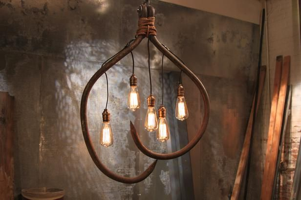 Metal roofing hooks wired with five Edison bulbs...made by participants on HGTV's Flea Market Flip!