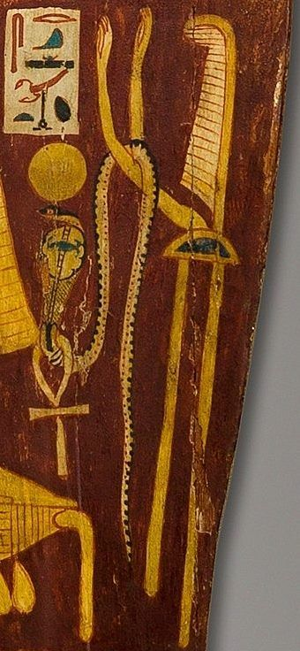 "the Goddess Selki (Srqt) represented as a personified standard of the ""West"" with the arms raised in adoration and an uraeus with the Solar disk and the 'Ankh'.  Detail from the inner side of the coffin of Henettawy,""Lady of the House"", ""Chantress of..."