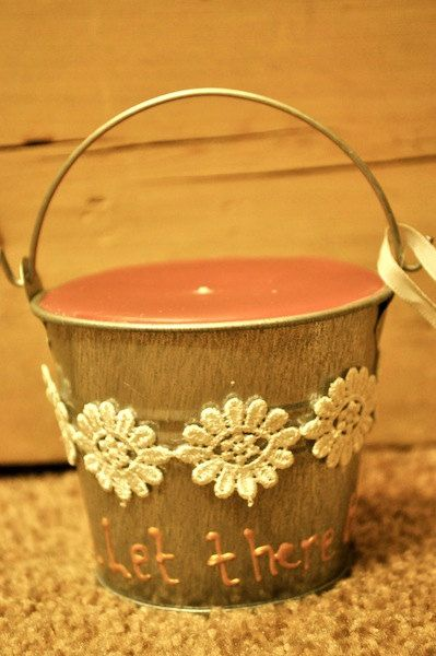 Homemade candle. Love the tin pail holder.