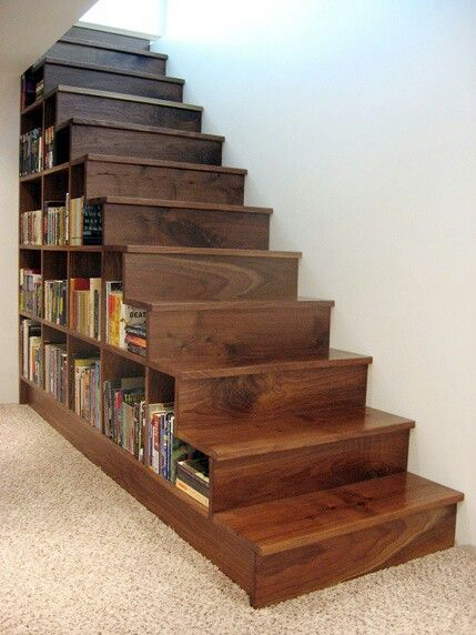 bookshelf built into stairs perfect for the basement