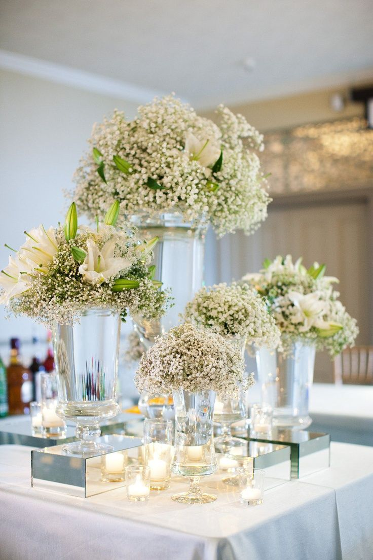 43 best referncias casamento 2 images on pinterest dream wedding cocos collection floral arrangements of babys breath and white lilies in different size vases are arranged to create depth izmirmasajfo Choice Image