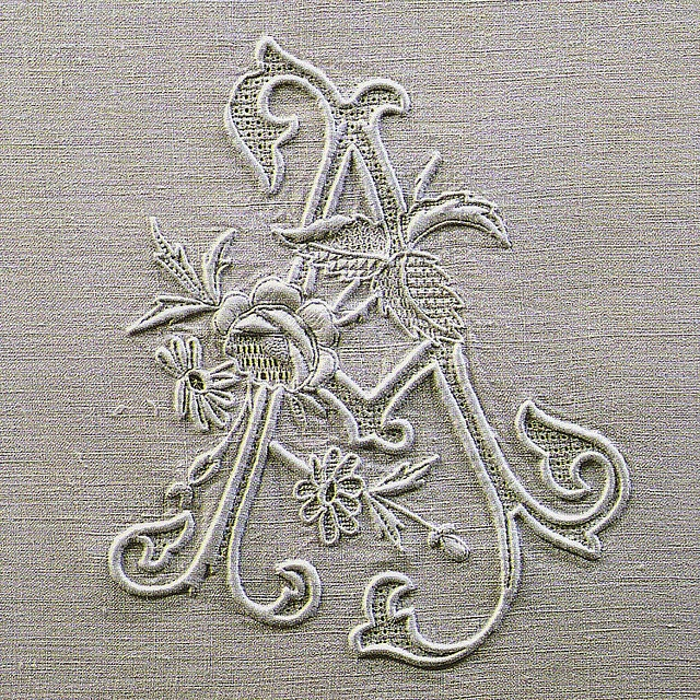 From an old, long out-of-print Italian book on beautiful monogram embroidery. It includes some of the best examples of this type of work I've ever seen. Many of these pieces were ebroidered for royal and titled families over the last century, hence the use of crowns in quite a lot of the work. The text is in italian.