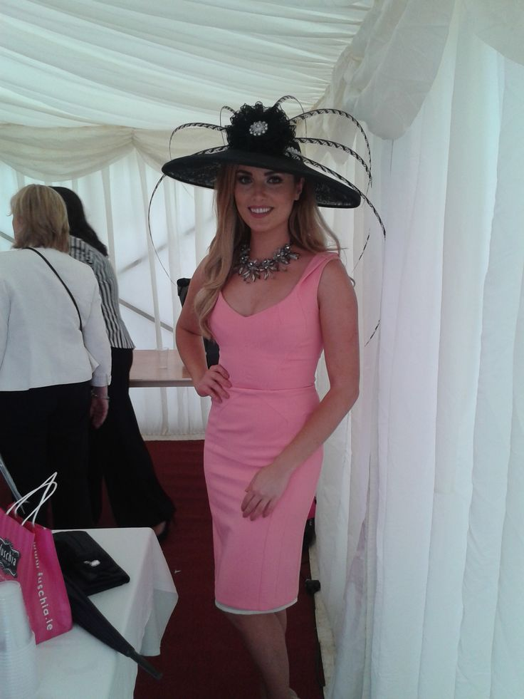 Celebrity judge and former Miss Ireland Holly Carpenter with a black lady amherst pheasant feather hat by JHK Millinery at Bellewstown Racecourse. This hat was worn by Ruth Heeney who made the Top 10 in the Best Dressed Lady Competition at Bellewstown Racecourse. #HollyCarpenter