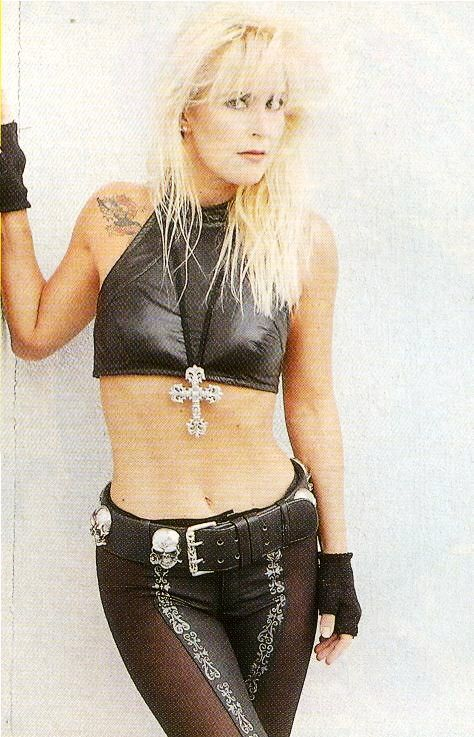 Lita Ford, yet another member of The Runaways: maybe they broke up because she had breasts and Joan Jett didn't?