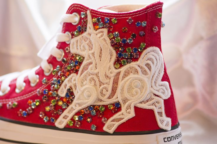The 'Bon Bon Silver Socks' pair (customisable design) £195  Chuck Taylor All Star Classic High top converse in Red   White Lace unicorn patch.  Rainbow gems.  These are so fun, glittery and always the center of attention.