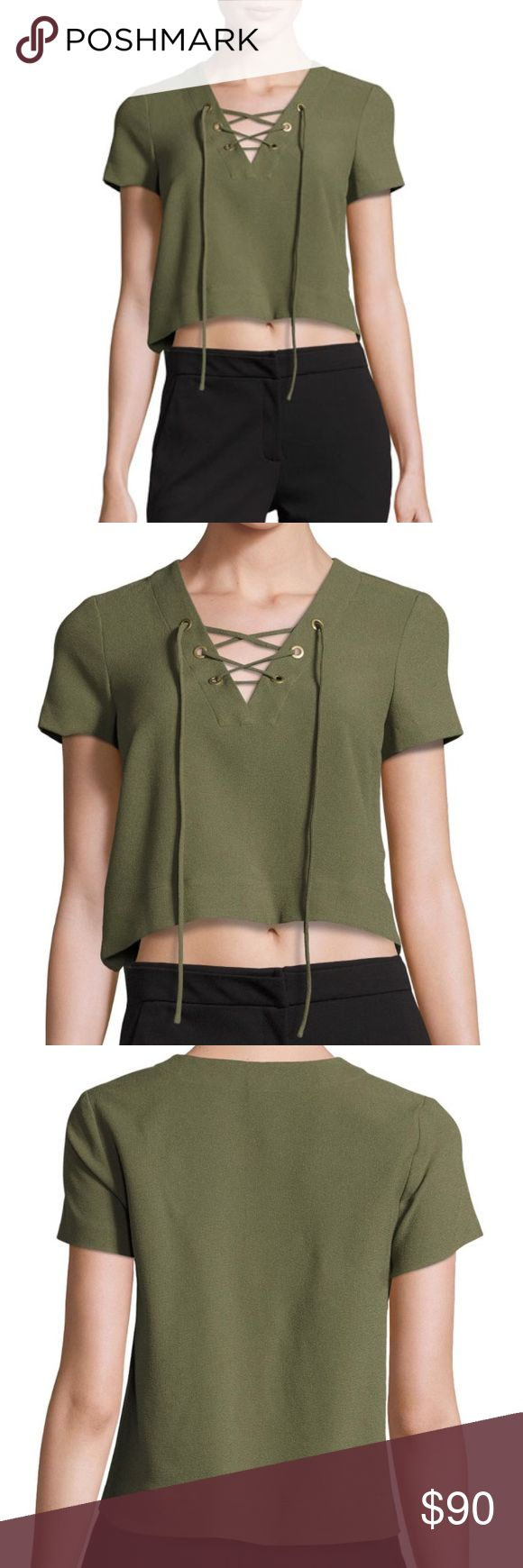 "Short-Sleeve Lace-Up Crop Blouse, Green BRAND NEW  Catherine Malandrino blouse. Lace-up neckline; short sleeves. Semi-fitted silhouette. Cropped hem. Polyester/spandex. Dry clean. Imported. About Catherine Malandrino: French designer Catherine Malandrino meshes the romance of Paris with the energy of New York. ""I design for the ultra-feminine, audacious, curious, and adventurous woman,"" says Malandrino, who presented her first collection in 1998.  Originally $148 from Neiman Marcus Catherine…"