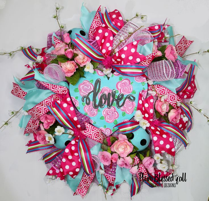 LOVE this in the air with this Valentine's Day decoration. Pink and turquoise blue Valentine's Wreath for the front door or home decor. Hand-painted sign with one-of-a-kind turquoise and black polka dot ornaments.