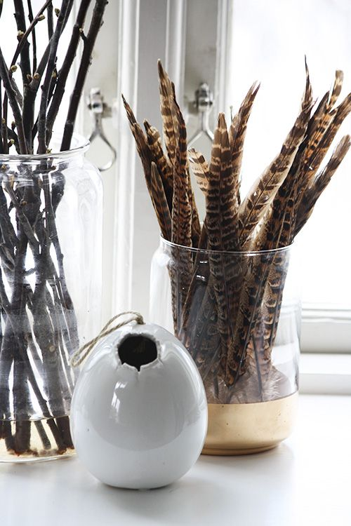 Branches + feathers in glass vessels