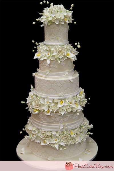 """""""We worked nonstop to create this cake and it includes the larger number of sugar flowers we've ever created for a wedding cake."""""""