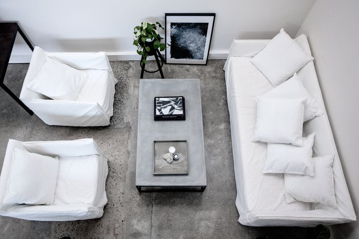 TheUNDONE   office   white couches   grey concrete coffee table   Gritty Pretty Magazine
