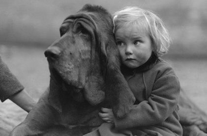 This is EXACTLY what my daughter looks like with my blood hound. Just not as dirty.. Usually. :)